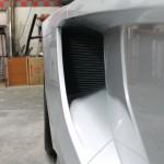 Entrada de ar lateral para o radiador